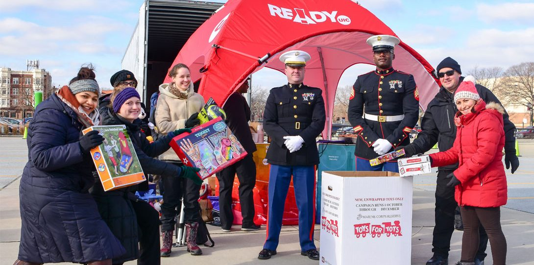 UIC students, faculty and staff interact with the marines while donating toys