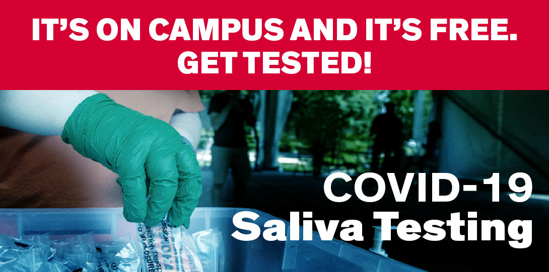 Decorative image. A hand with a medical glove picks a saliva test from a tray. It's on campus and it's free. Get tested!